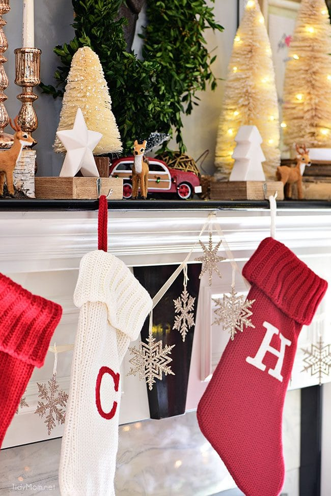 Red and white Christmas stockings. Merry and Bright Christmas Mantel Decor with rustic neutrals and a touch of red and green. Details at TidyMom.net