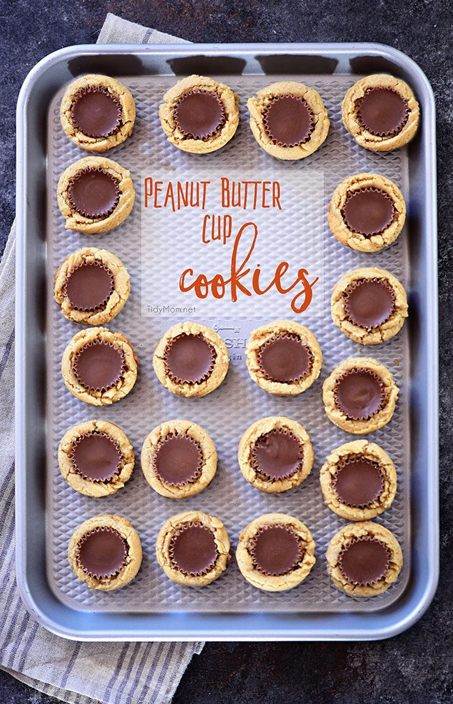 If you like peanut butter, you're going to LOVE these Peanut Butter Cup Cookies. A peanut butter cookie cup with a chocolate covered peanut butter cup in the middle! A favorite treat any time of year, and perfect for Christmas cookie trays! They are super easy to make if you follow a few tips I'm sharing. Get cookie tips and print recipe at TidyMom.net