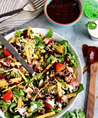 This BBQ Chicken Salad is super easy, can even be made with leftovers and it's off the hook delicious! Grilled corn and lime crema really make it sing!  If you were a fan of Panera's BBQ Chicken Salad, you're going to love this copycat salad you can make in 15 minutes or less at home! Print the full recipe at TidyMom.net