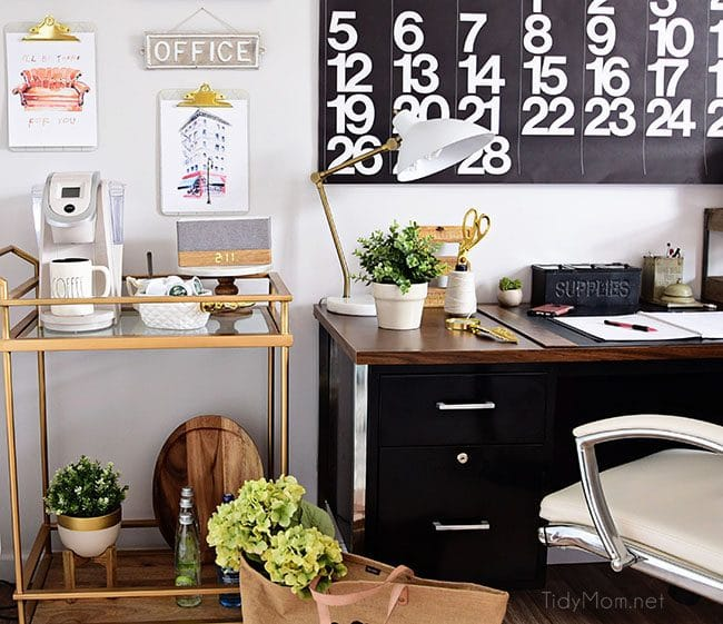 Decorating a shared home office, with colorful industrial style. Her side is pink and gold, while his is black and neutrals. Check out the gold coffee cart!! Get all the details of this shared home office space at TidyMom.net