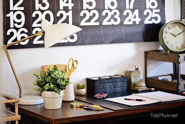 Decorating a shared office, with colorful industrial style. Her side is pink and gold, while his is black and neutrals. Check out the gold coffee cart!! Get all the details of this shared home office space at TidyMom.net