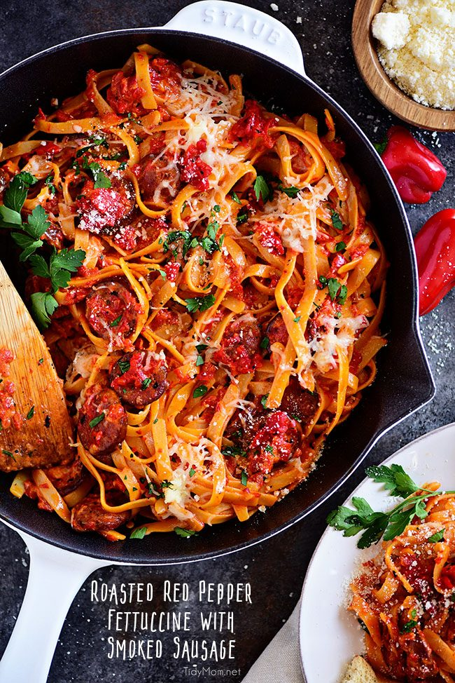 Delicious Roasted Red Pepper Fettuccine with Smoked Sausage in white Staub skillet