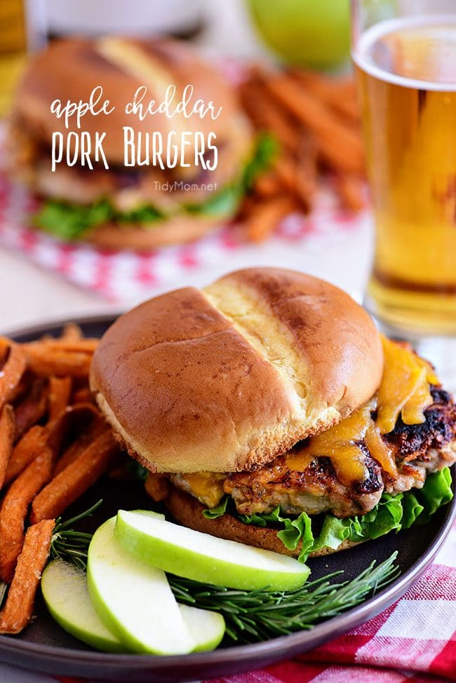 Apple Cheddar Pork Burgers are a simple dinner solution the whole family will devour!! Made with just five ingredients andpacked with flavor, tart apples and sharp cheddar (inside and out) are going to elevate your burgers to a whole new dimension with an unexpected flavor that everyone is going to love!Print full recipe at TidyMom.net #burgers #pork