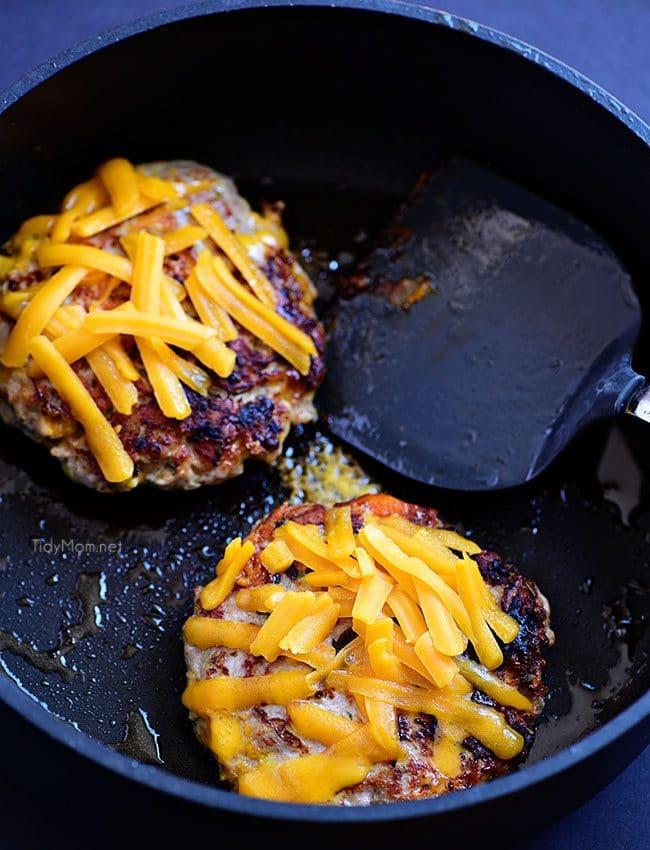 Pork and apples go together like peanut butter and jelly. Add rosemary and sharp cheddar you've elevated the flavors to a whole new dimension. Mix-up burger night with these Apple Cheddar Pork Burgers for an unexpected flavor they're going to love!