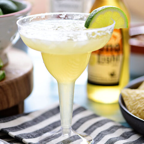 This easy recipe for a Beer Margarita has only 3 ingredients and is dripping with Mexican flavors. The best Beergarita is light, not too sweet, refreshing and super easy, to make!When you combine tequila, beer, and frozen limeade, you have something for the cocktail lover and brewski lover. Perfect for Cinco de Mayo or any celebration! Get this #cocktailrecipe at TidyMom.net #margarita #cocktails