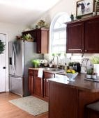 kitchen with cherry cabinets and creamy white walls