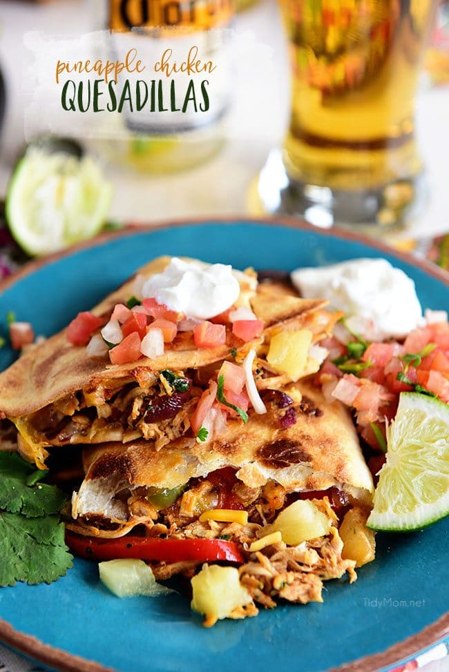 Oven-Baked Pineapple Chicken Quesadillas are super easy to make and you'll have dinner in under 20 minutes. They are stuffed with southwest seasoned chicken, caramelized pineapple, sweet peppers, onions and lots of melty cheese.
