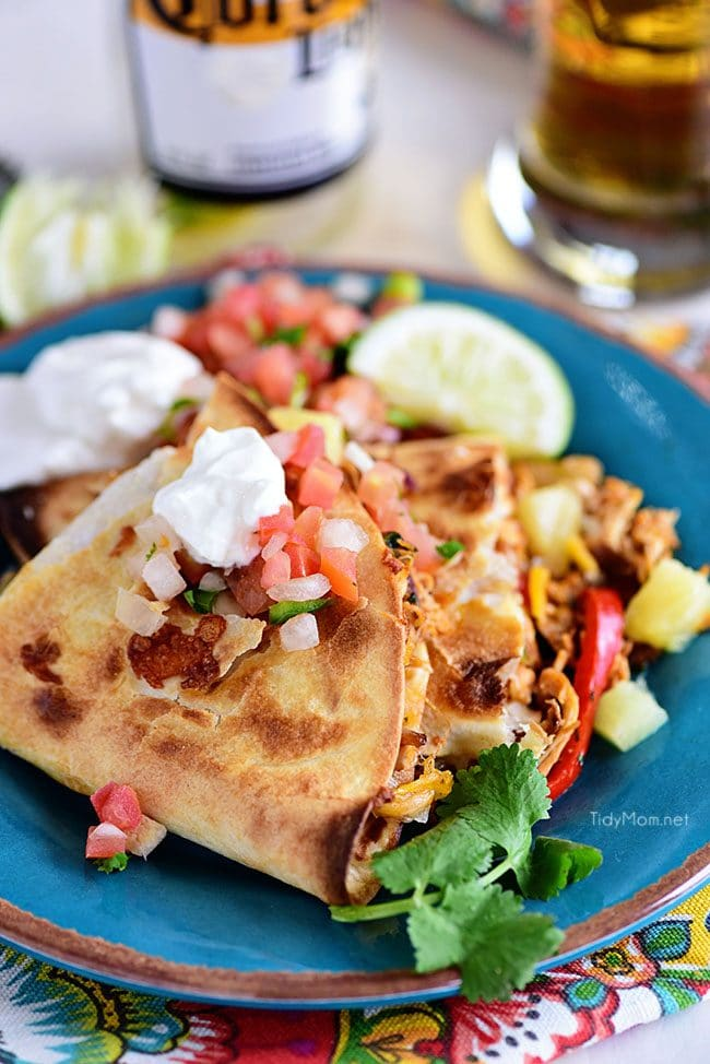 Pineapple chicken Quesadillas are stuffed with sweet peppers, caramelized onion, pineapple and lots of melty cheese.