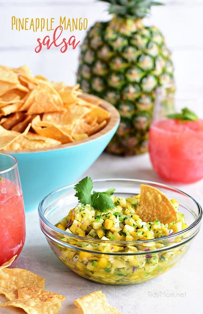 A tropical fruit salsa with a kick of jalapeno that will knock your socks off! This Pineapple Mango Salsa recipe is the perfect addition to chicken, pork, fish, tacos or tortilla chips. Print full recipe at TidyMom.net #salsa