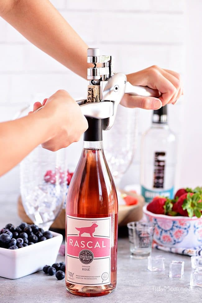 Pink Summer Sangria with berries. Opening bottle of rose with The Original Rabbit Cork Screw