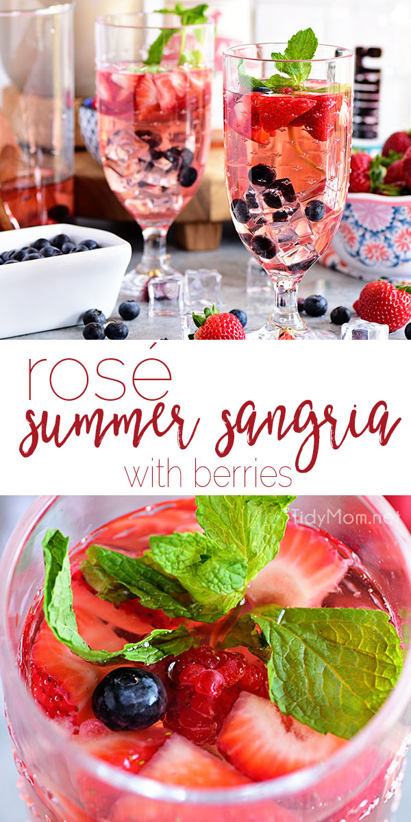 This quick and simple Rosé Summer Sangria is perfect for cooling off in the summer heat. Wow your guests by serving sangria made with fresh berries, rosé wine, and kicked up with white rum at your next party or BBQ. Print full recipe at TidyMom.net #cocktail #sangria #rosé #wine #strawberry