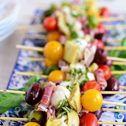 Wow your guests with bright and flavorful antipasto skewers. An easy make-ahead appetizer with a new delicious discovery in every bite. Perfect for any occasion, this party food comes together fast and is endlessly customizable. Print the recipe at TidyMom.net