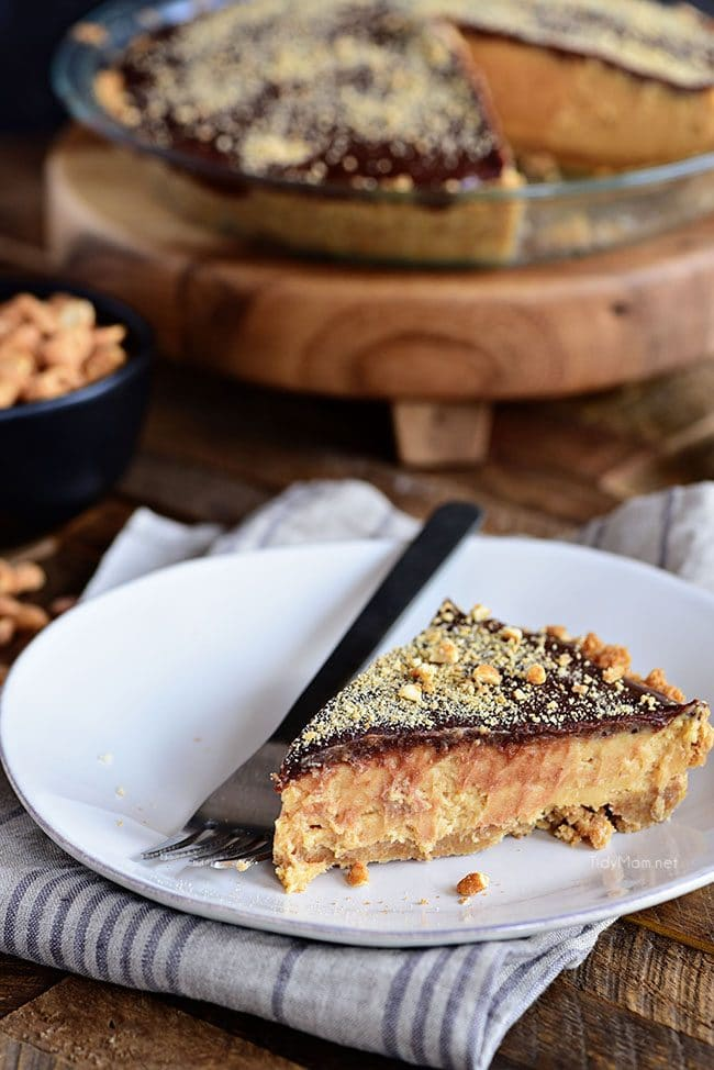 Dessert doesn't get any better than this ultra-rich Chocolate Peanut Butter Pie with layers of graham cracker, peanut butter filling, and chocolate. It's pie perfection. Print full recipe at TidyMom.net