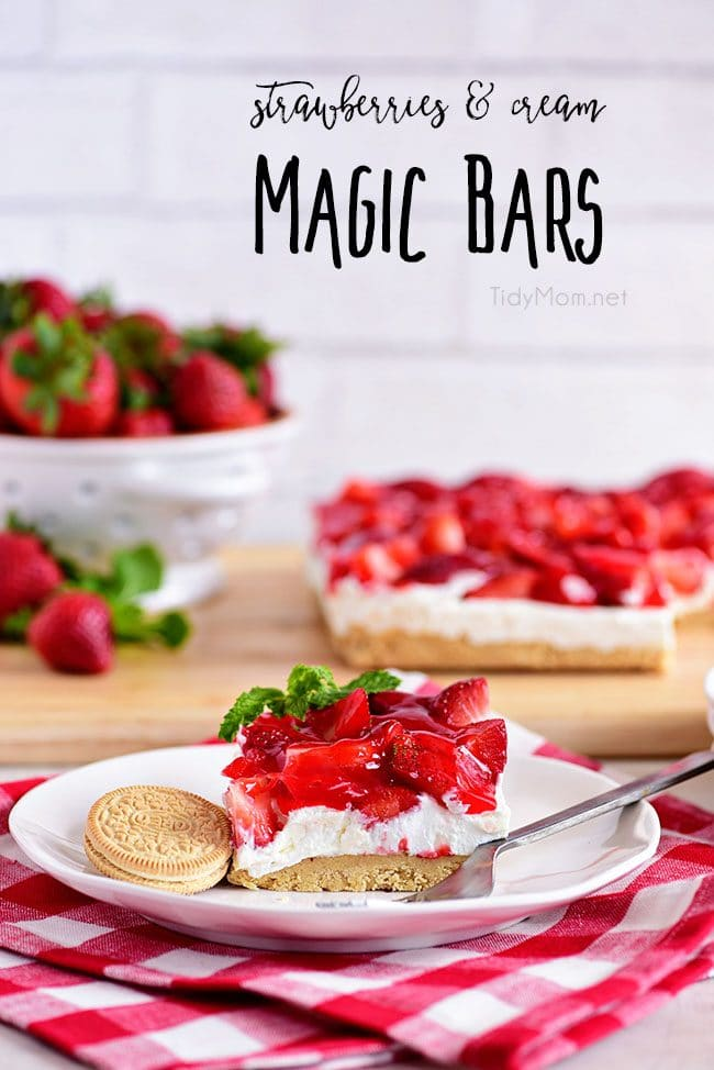Strawberries and Cream Magic Bars made with fresh glazed strawberries and a sweet cream cheese layer with a Golden Oreo cookie crust! Chill for a tasty summer dessert!  Print the full recipe at TidyMom.net #strawberry #magicbars #dessert
