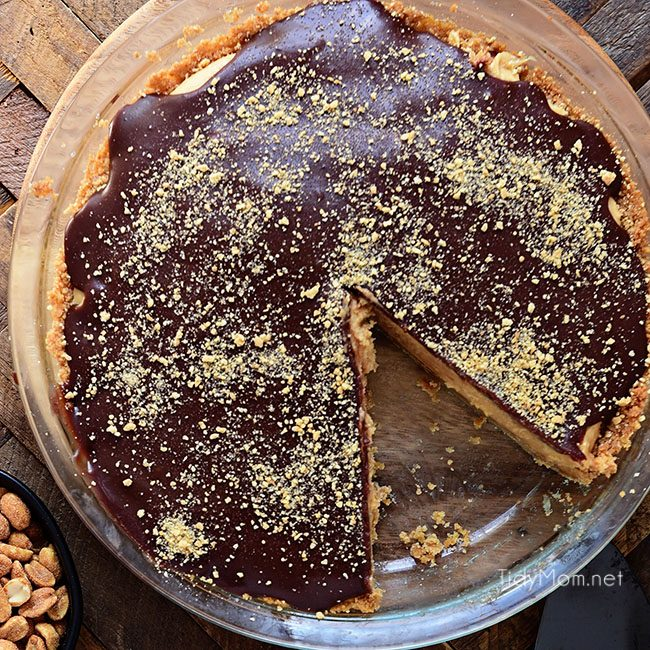 Every other pie out there is going to be jealous of this Chocolate Peanut Butter Pie. From the graham cracker crust to the peanut butter filling, topped off with a chocolate ganache, this chocolate peanut butter pie has it all! Print full recipe at TidyMom.net