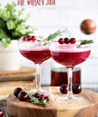 The fruity cherry and cranberry notes in this Cran-Cherry Rye Whiskey Sour Cocktail complement the spicy rye and tone down its bite.  An egg white in my cocktail? You betcha! Utterly the perfect cocktail for winter or any time of year. Get the full recipe at TidyMom.net #cocktail #cocktails #whiskeysour #cranberry #cherry #rye