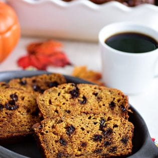 The aroma when this Chocolate Chip Pumpkin Banana Bread comes out of the oven is nothing short of heaven! This is the quick bread recipe every pumpkin spice lover needs! It's perfect for dessert, breakfast, gifting or just snacking!
