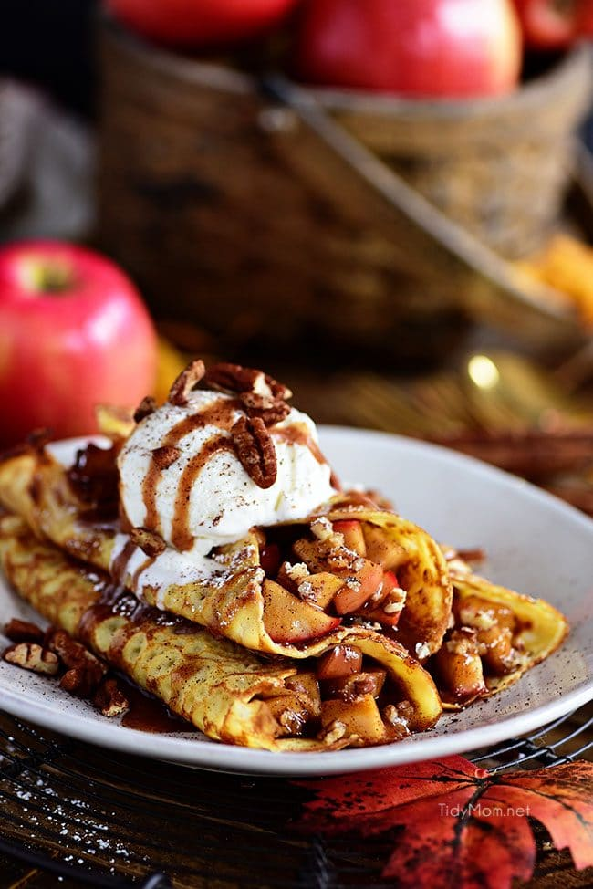 This Apple Crepes recipe is perfect for fall. The thin french pancakes are filled with a gooey caramel apple compote with toasted cinnamon pecans.