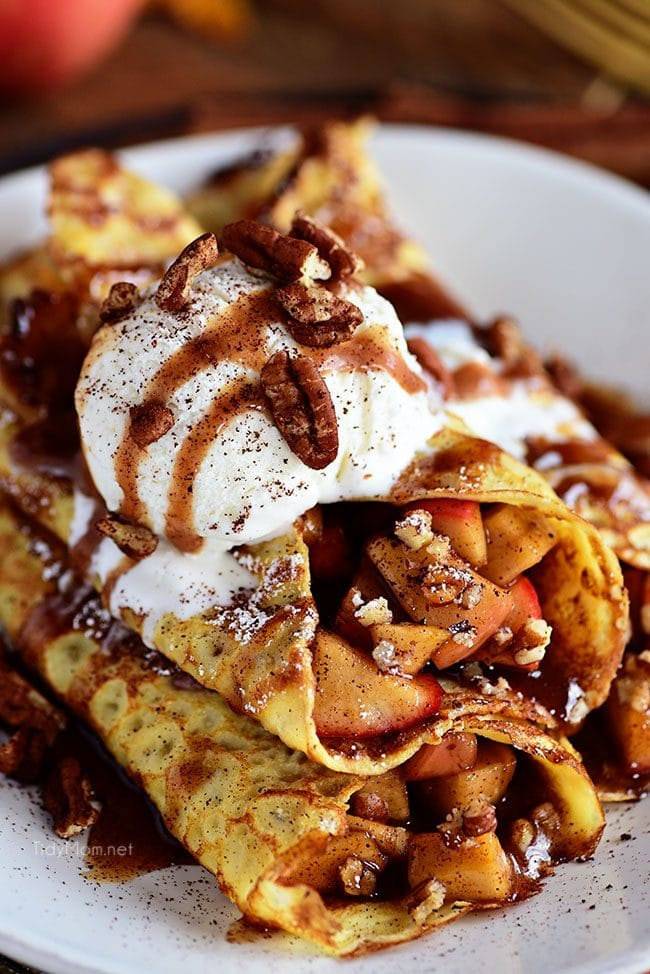 These apple pie crepes make the perfect treat anytime of the day. Top them with vanilla ice cream for dessert crepes that everyone will be talking about! Get the easy recipe at TidyMom.net #crepes #apple #applepie #appledessert