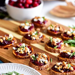 Cranberry Walnut Sweet Potato Rounds on wooden tray