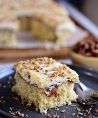 Caramel Butter Pecan Cake With Bourbon Frosting sliced on a plate