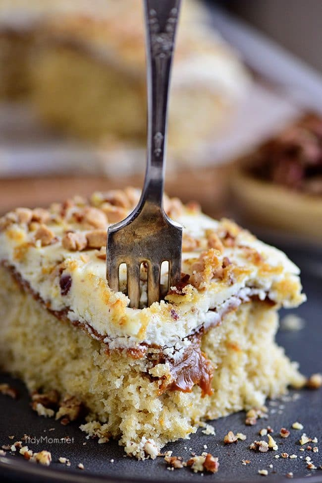 fork into a piece of Caramel Butter Pecan Cake With Bourbon Frosting