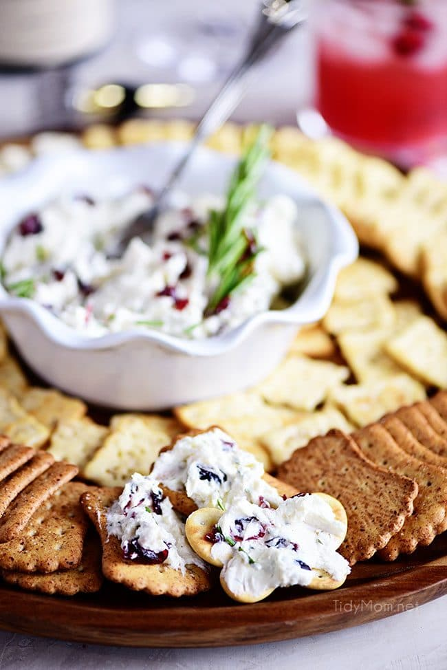 Cranberry Cream Cheese Dip in a bowl on tray with crackers