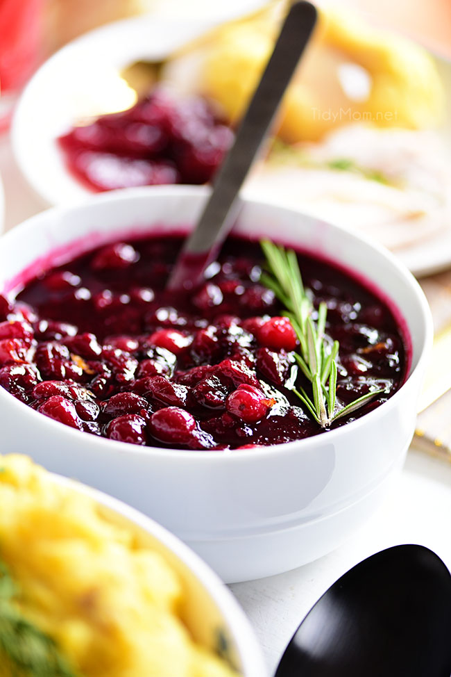 Impress your guest with homemade Fresh Cranberry Sauce.  The mixture of fresh cranberries, blueberries, and raspberries and a hint of spice will quickly become a traditional must-have for your next holiday dinner.  Visit TidyMom.net to print the full recipe #cranberrysauce #thanksgiving #homema