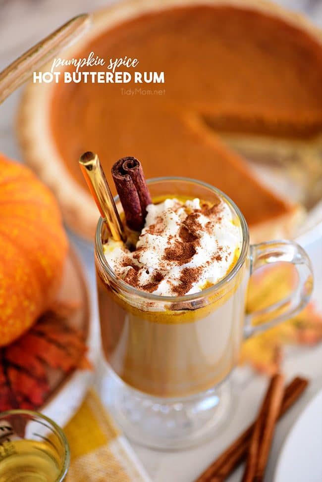 Pumpkin Spice Hot Buttered Rum next to a pumpkin pie