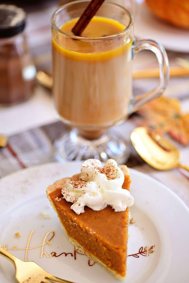 Pumpkin Spice Hot Buttered Rum with piece of pumpkin pie