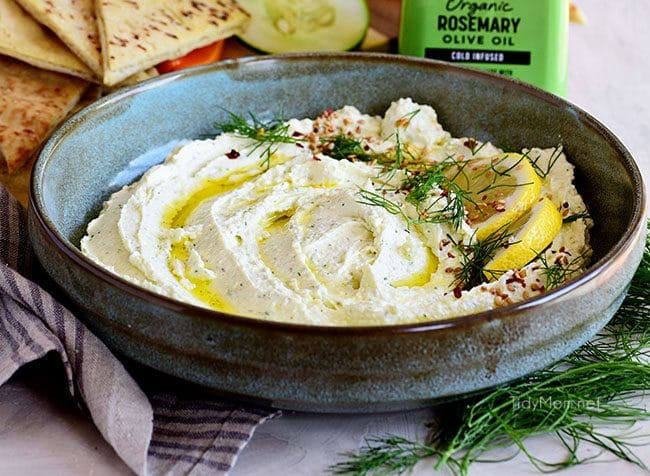 whipped feta in bowl with lemon and olive oil