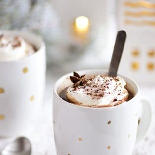 Butterscotch Schnapps Spiked Hot Chocolate in mugs with spoon