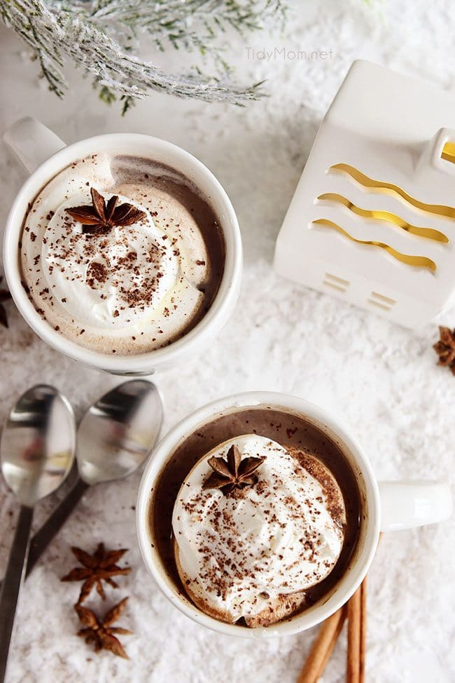 Butterscotch Schnapps Spiked Hot Chocolate in mugs with whip cream on top