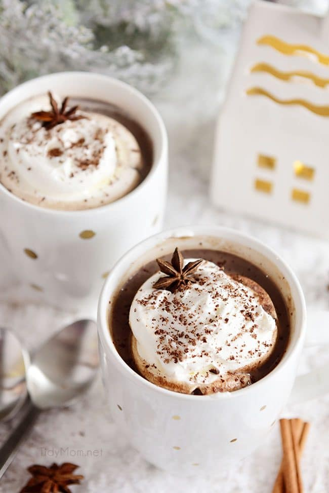 two mugs Butterscotch Schnapps Spiked Hot Chocolate with whipped cream