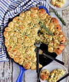 Cheesy Pull-Apart Garlic Bread dished up on plate from skillet