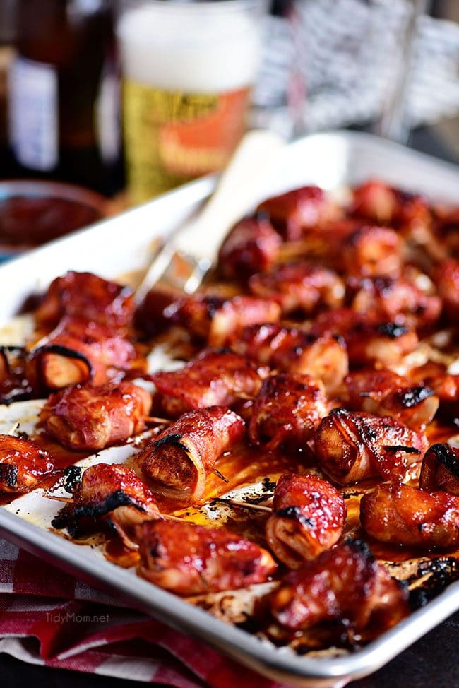 BBQ Bacon Wrapped Chicken Bites on parchment lined pan