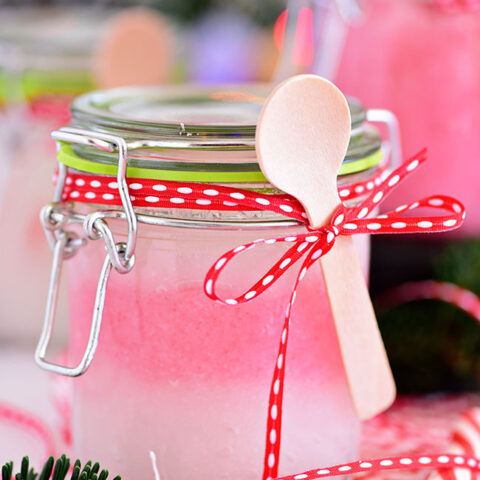 Handmade 3 ingredient Peppermint Sugar Scrub in a jar with spoon