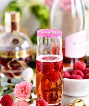 Raspberry Kir Royale cocktail in champagne flute