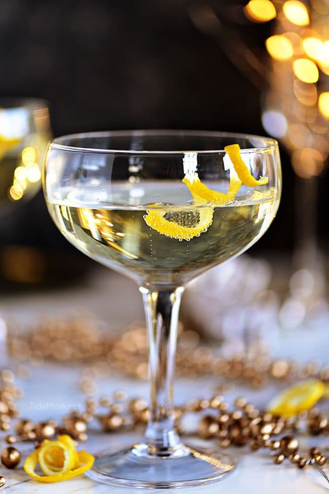 Twinkle champagne cocktail with lemon twist