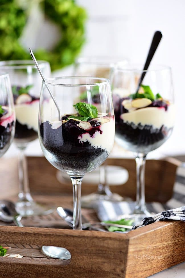 Chocolate Cherry Cheesecake Parfaits in wine glasses