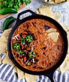 Creamy Chorizo Cheese Dip in cast iron skillet and chips