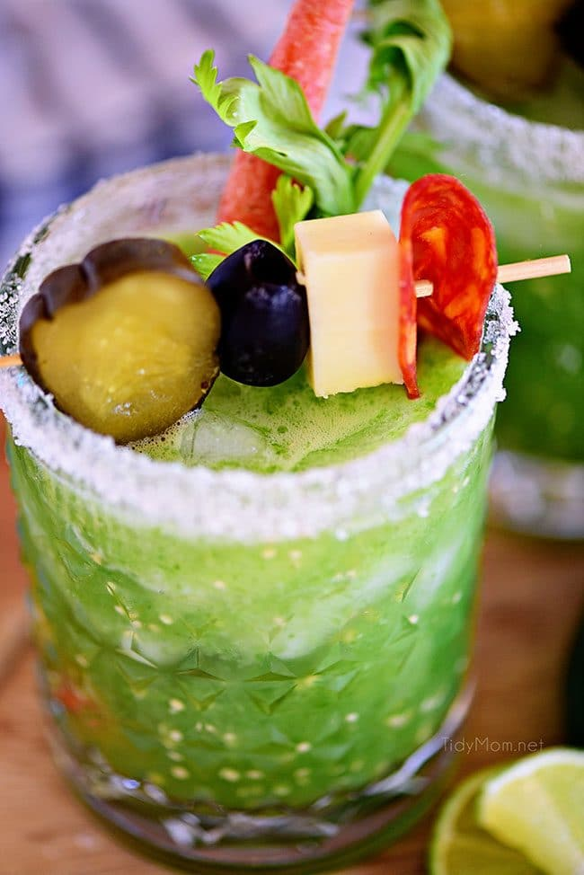 Verde Mary or Green Bloody Mary with garnishes in cocktail glass