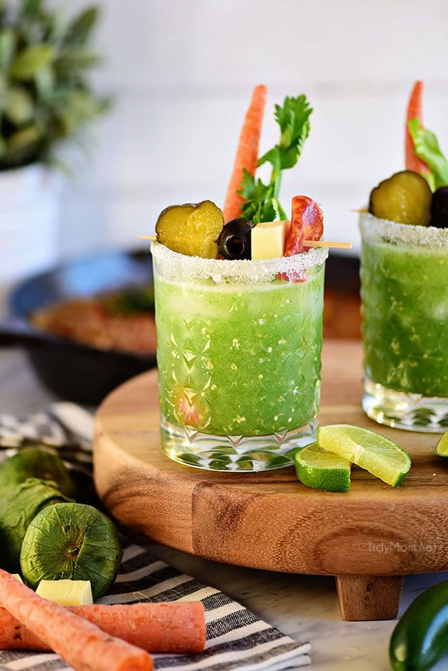 Verde Mary or Green Bloody Mary on track with lime slices