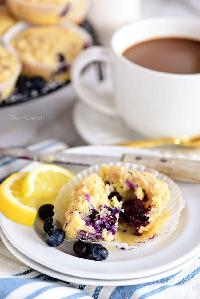 LEMON BLUEBERRY MUFFINS cut open served with mug of coffee
