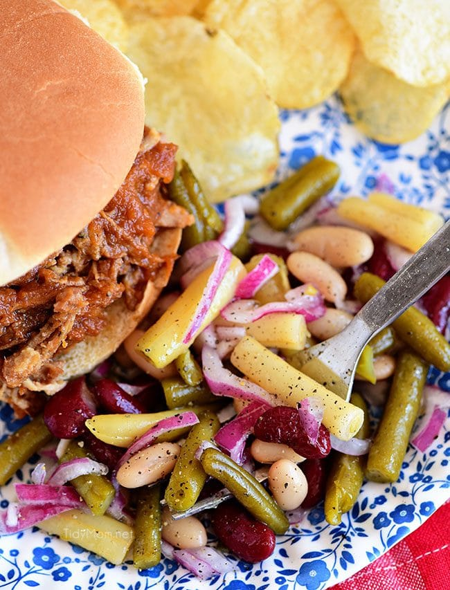 Bean salad on a plate with pulled pork