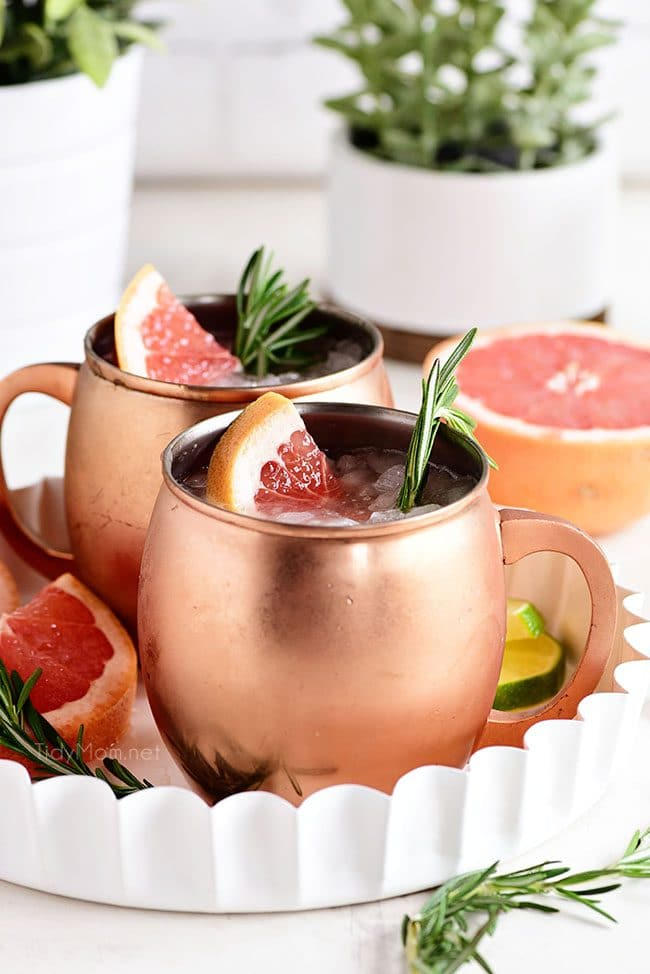 Fresh Grapefruit Moscow Mule cocktails in copper mugs