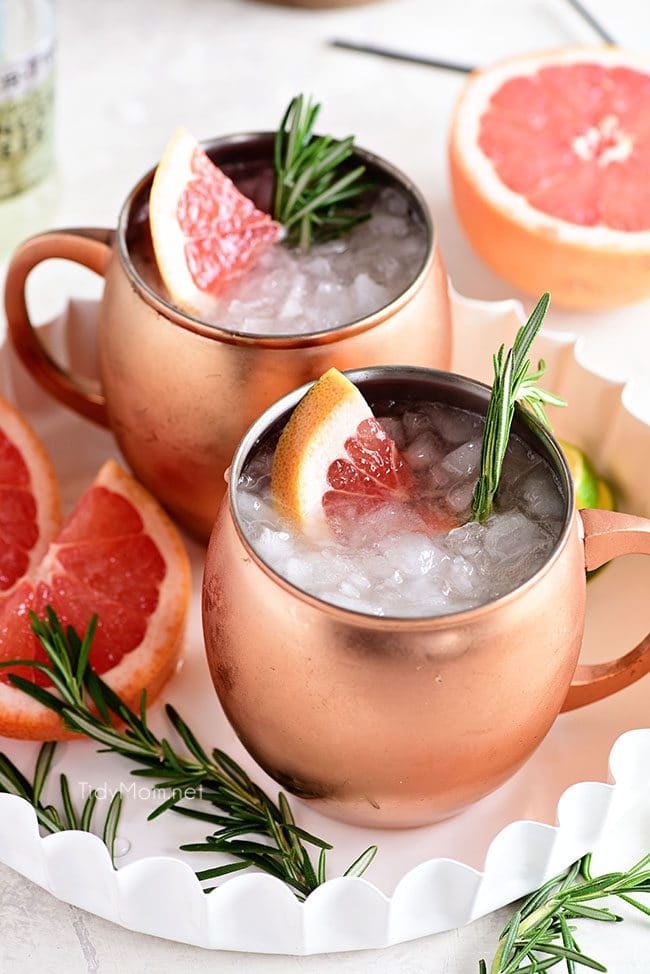 2 Grapefruit Moscow Mule cocktails with fresh grapefruit
