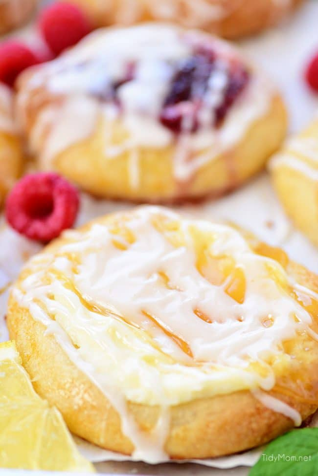 Homemade Cream Cheese Danishes with lemon and raspberry close up