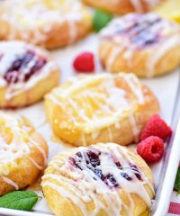 Cream Cheese Danishes with lemon and raspberry on a pan