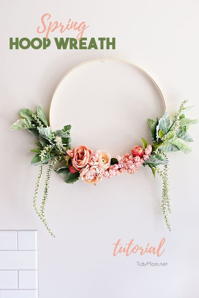 Blush and green spring floral hoop wreath on wall